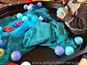 material sensory play in a tuff spot