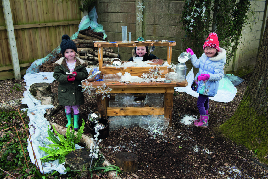 Messy play and mud kitchens with snow and ice outdoors