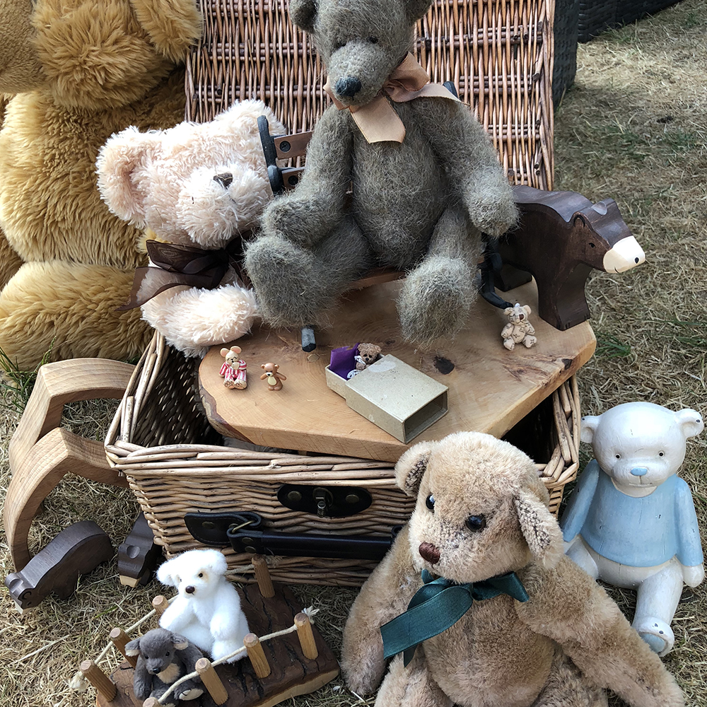 Provocations in a basket or suitcase by Lottie Makes