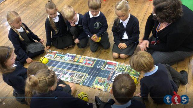 Children around the Bee Bot mat.