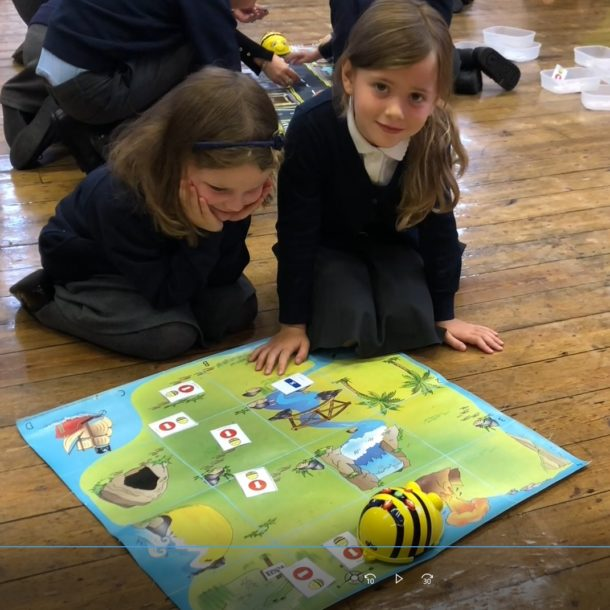 Pairs work on programming the Bee Bot around the treasure map.