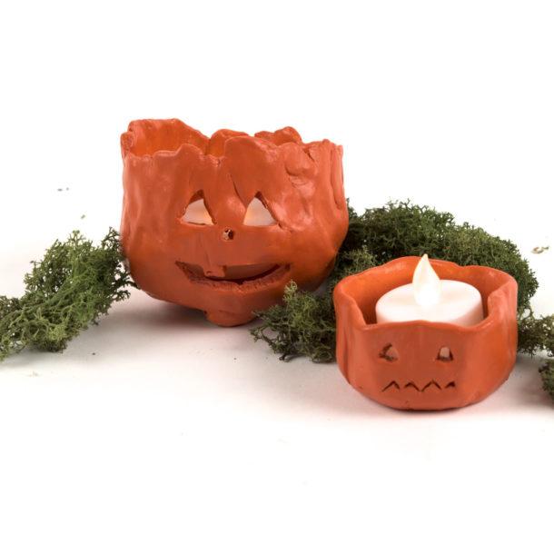 Two finished pumpkin lanterns.