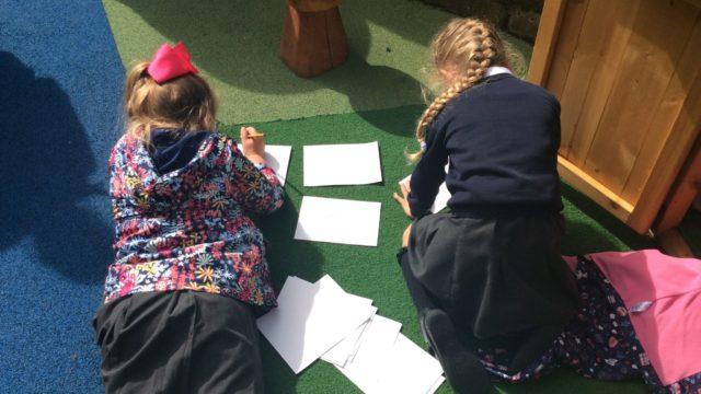 Children creating tickets for their drum show.