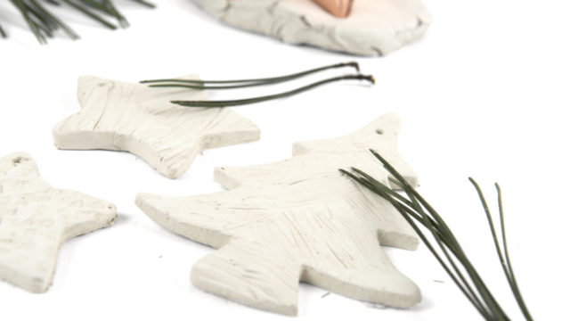 using pine needles to create patterns in clay shapes
