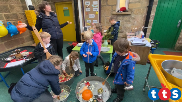 Children mixing their potions with different sized spoons