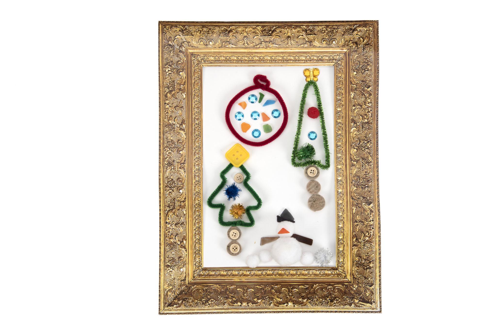 Vintage, golden card frames around children's art work.