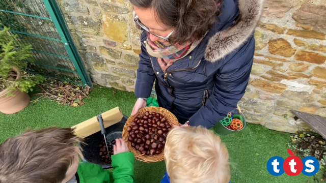 Children counting out conkers