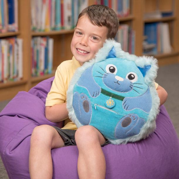 Little boy holding the blue Calming Cat